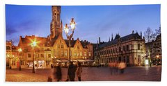 Beach Towel featuring the photograph Burg Square At Night - Bruges by Barry O Carroll