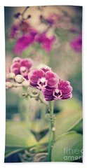 Beach Towel featuring the photograph Burgundy Orchids by Ana V Ramirez