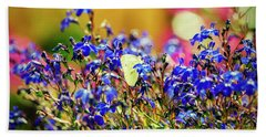 Butterfly On Flowers Beach Towel by Mike Santis