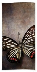 Butterfly Over Textured Background Beach Towel