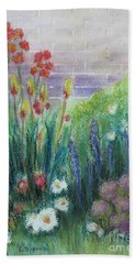 By The Garden Wall Beach Towel