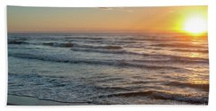 Calm Water Over Wet Sand During Sunrise Beach Towel