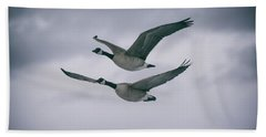 Beach Towel featuring the photograph Canadian Geese In Flight by Jason Coward