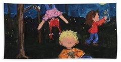 Catching Fireflies Beach Towel