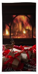 Christmas Gifts By The Fireplace Beach Towel