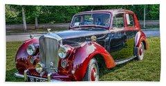 Classic Bentley In Red Beach Sheet