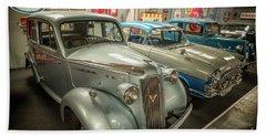 Beach Towel featuring the photograph Classic Car Memorabilia by Adrian Evans