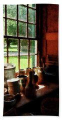 Beach Towel featuring the photograph Clay Jars On Windowsill by Susan Savad