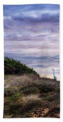 Cliffside Watcher Beach Towel