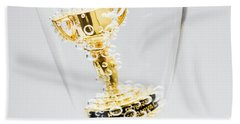Closeup Of Small Trophy In Champagne Flute. Gold Colored Award I Beach Towel
