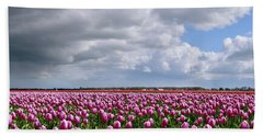 Clouds Over Purple Tulips Beach Sheet by Mihaela Pater