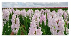 Clouds Over The Pink Hyacinth Field Beach Towel by Mihaela Pater