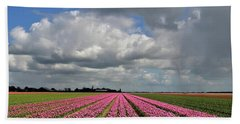 Clouds Over The Purple Tulip Field Beach Towel by Mihaela Pater