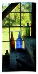 Beach Towel featuring the photograph Colored Bottles On Steps by Susan Savad