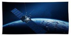 Communications Satellite Orbiting Earth Beach Towel