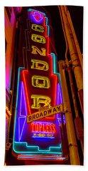 Condor Neon On Broadway Beach Towel