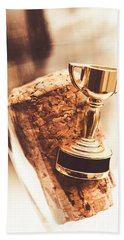 Cork And Trophy Floating In Champagne Flute Beach Towel