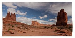 Courthouse Towers And The Three Gossips Beach Sheet by Alan Vance Ley