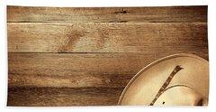 Cowboy Hat On Wood Table Beach Towel