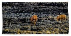 Cows On The Rocks Beach Towel