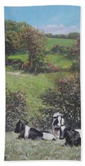 Beach Towel featuring the painting Cows Sitting By Hill Relaxing by Martin Davey