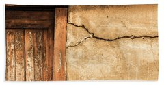 Cracked Lime Stone Wall And Detail Of An Old Wooden Door Beach Sheet by Semmick Photo