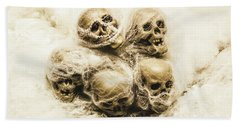 Creepy Skulls Covered In Spiderwebs Beach Towel