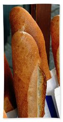 Crusty French Bread Loaves Display At Bakery Entrance Beach Towel