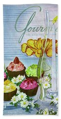 Cupcakes And Gaufrettes Beside A Candle Beach Towel