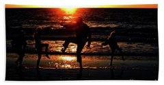 Dancing In The Sun Beach Towel by Gary Wonning