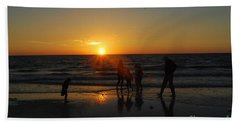 Dancing In The Sunset Beach Towel by Gary Wonning