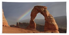 Beach Towel featuring the photograph Delicate Arch And Rainbow by Marie Leslie