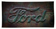 Detail Old Rusty Ford Pickup Truck Emblem Beach Towel