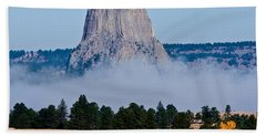 Beach Towel featuring the photograph Devil's Tower Standing In Fog by Rikk Flohr