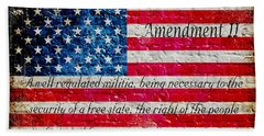 Distressed American Flag And Second Amendment On White Bricks Wall Beach Towel by M L C