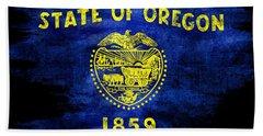 Distressed Oregon Flag On Black Beach Sheet by Jon Neidert