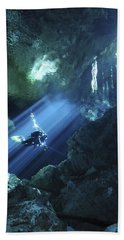 Diver Silhouetted In Sunrays Of Cenote Beach Towel by Karen Doody