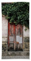 Beach Towel featuring the photograph Door Covered With Ivy by Marco Oliveira