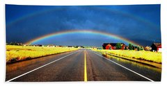 Double Rainbow Over A Road Beach Towel by Matt Harang