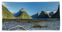 Beach Towel featuring the photograph Driftwood In Milford Sound by Gary Eason