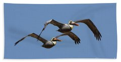 Duel Pelicans In Flight Beach Towel