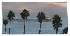 Beach Towel featuring the photograph Dusk At The Pier by Suzanne Oesterling
