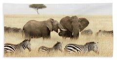 Elephants And Zebras In The Grasslands Of The Masai Mara Beach Towel