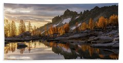 Enchantments Golden Sunrise Larches Reflection Beach Towel by Mike Reid
