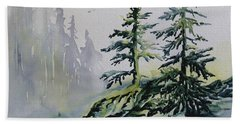 Evergreens In The Mist Beach Towel