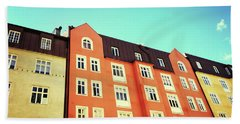 Facades Of Colorful Buildings In Stockholm Beach Towel