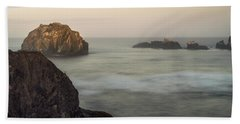 Face Rock Sunrise Beach Towel