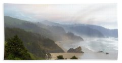 Falcon And Silver Point At Oregon Coast Beach Towel