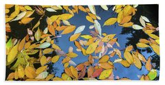 Beach Towel featuring the photograph Fallen Autumn Leaves In Garden Pond by Jit Lim