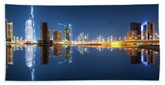 Fascinating Reflection Of Tallest Skyscrapers In Business Bay District During Calm Night. Dubai, United Arab Emirates. Beach Towel